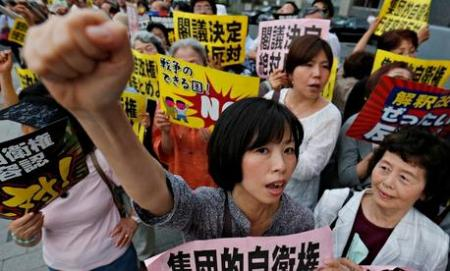 Supporters of the current constitution demonstrated outside the Japanese prime minister's official residence in Tokyo on Monday evening. Photograph: Shizuo Kambayashi/AP