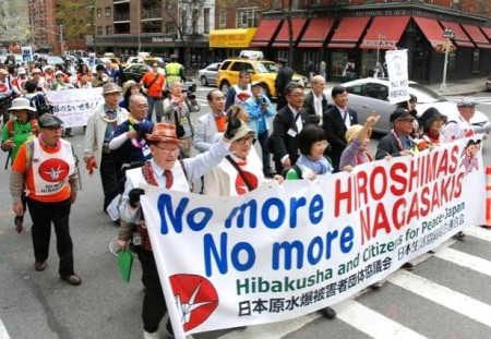 Atomic bomb survivors and peace campaigners take part in a march through New York last Sunday ahead of the U.N. conference to promote nuclear disarmament and nonproliferation that was to start Monday. | KYODO