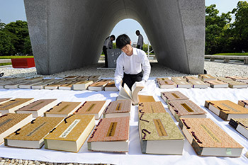 Airing books containing the names of atomic bomb victims of Hiroshima and Nagasaki at the Hiroshima Peace Memorial Park